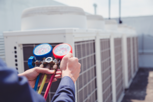 HVAC repair technician inspecting a system in Lake Zurich, Illinois