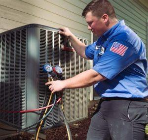 HVAC repair technician at a house in Long Grove, Illinois