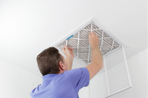 Replacing the HVAC filter in a house in Harvard, Illinois